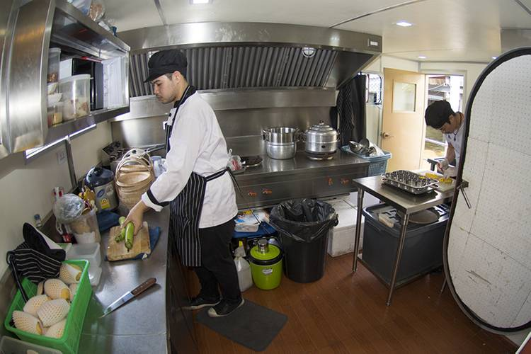 Chefs prepare dinner for up to 90 guests in the well laid out and equipped galley. (Photo: Haig-Brown/Cummins)