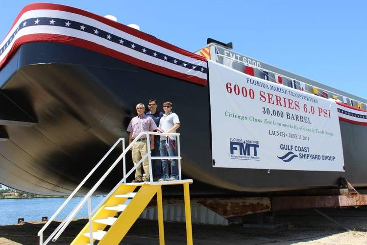 Christening of FMT's 6,000 Series Barge by Gulf Coast Shipyard Group, FMT CEO Dennis Pasentine and sons Dennis J. and John Pasentine