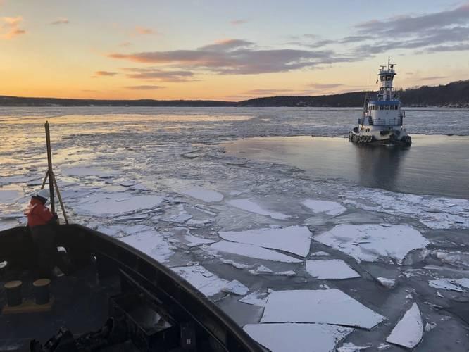 Coast Guard Cutter Penobscot Bay helps break free tug Stephanie Dann from the ice on the Hudson River near Kingston, N.Y. (U.S. Coast Guard photo by Steven Strohmaier, courtesy of Coast Guard Cutter Penobscot Bay)
