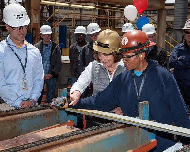 Congresswoman Susan Davis measures the first piece of steel for the fourth American Petroleum Tanker. (Photo: General Dynamics NASSCO)