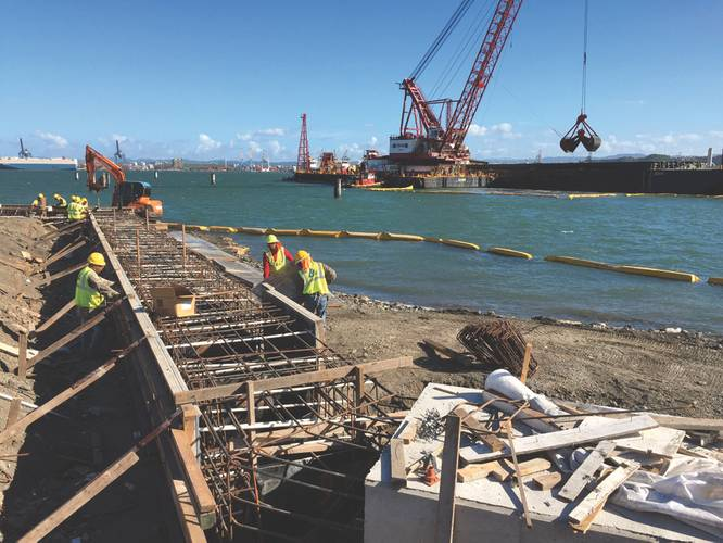 Crews construct part of the structure of the new terminal and pier that Crowley Maritime Corp. is developing at Isla Grande in San Juan, Puerto Rico. The terminal and pier are part of an investment of more than $500 million by Crowley in trade with Puerto Rico. With more than 60 years serving the U.S. island, Crowley is the longest serving ocean carrier for Puerto Rico. (Photo: Crolwey)