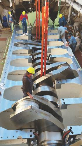 Crews lower the crankshaft for El Coqui, one of two combination container/Roll-on Roll-off (ConRo) ships under construction for Crowley Maritime Corp. that will be powered by liquefied natural gas for the Jones Act trade between the U.S. and Puerto Rico. (Photo: Crowley)