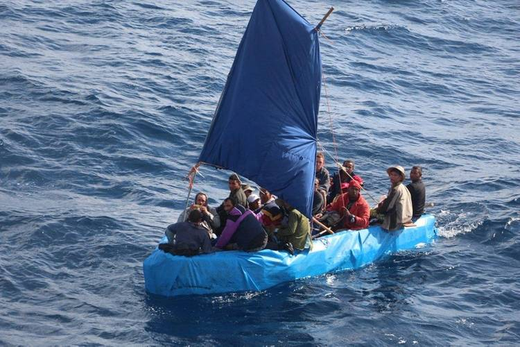 Cuban migrants sail a rustic vessel south of Key West, Florida, Jan. 1, 2015. The Coast Guard Cutter Mohawk interdicted the 24 Cuban migrants and were later repatriated to Bahia de Cabañas, Cuba. (U.S. Coast Guard photo)