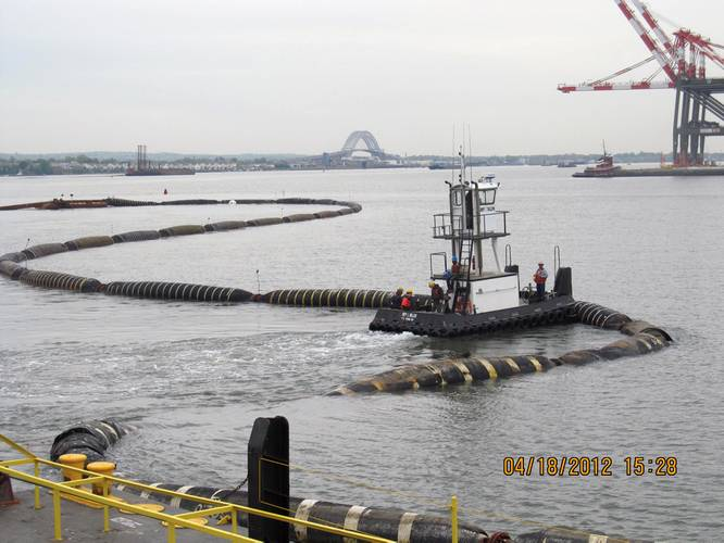 Dredged sand was used to cap or close the Newark Bay CDF. This photo shows the floating pipeline that connected the dredge to the pump barge at the CDF site. Credit: Linda Guenther, Project Engineer, Dredging Program, New York District, U.S. Army Corps of Engineers.