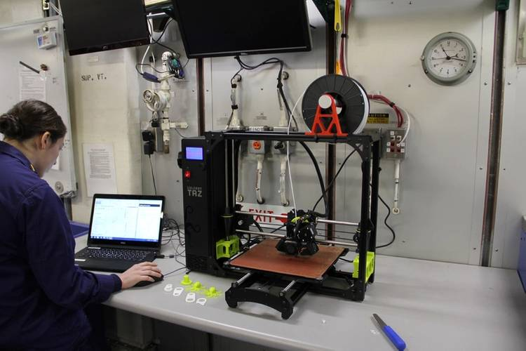 Ensign Abigail Isaacs uses a 3-D printer aboard Coast Guard Cutter Healy (U.S. Coast Guard photo)