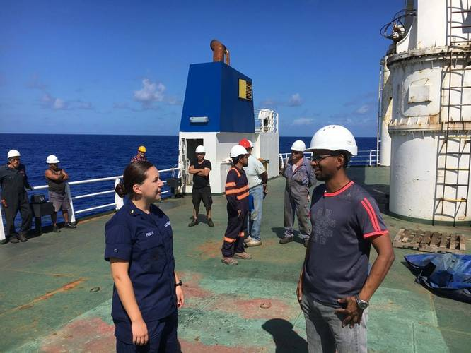 Ensign Samantha Penate, from the Coast Guard Cutter Confidence, speaks with the master of Alta to determine the situation aboard their disabled cargo ship in the Atlantic Ocean, October 7, 2018. The ship became disabled more than 1,000 miles from shore on September 19. U.S. (Coast Guard photo by Todd Behney)