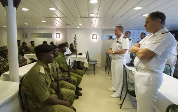 EU Naval Force Deputy Commander, Rear Admiral Bartolomé Bauzá (right) and Force Commander Hervé Bléjean meeting with Tanzanian participants during the training. (EU NAVFOR Photo)