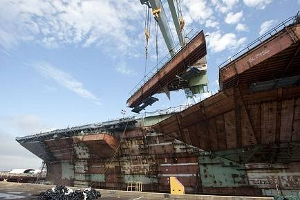 Newport News Shipbuilding's 1,050-metric ton gantry crane lifts the forward end of one of aircraft carrier Gerald R. Ford's (CVN 78) catapults into place, bringing more than three years of structural erection work to a close. Photo courtesy of Huntingdon Ingalls Industries