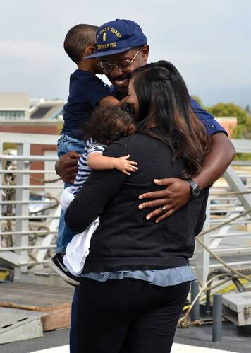 Family and friends met aboard the Coast Guard Cutter Bertholf's flight deck to reunite with Bertholf crewmembers following the cutter's return home to Alameda, Calif., after a 90-day deployment, Sept. 4, 2018. Bertholf is one of four 418-foot National Security Cutters homeported in Alameda. U.S. Coast Guard photo by Petty  Family and friends met aboard the Coast Guard Cutter Bertholf's flight deck to reunite with Bertholf crewmembers following the cutter's return home to Alameda, Calif., after a