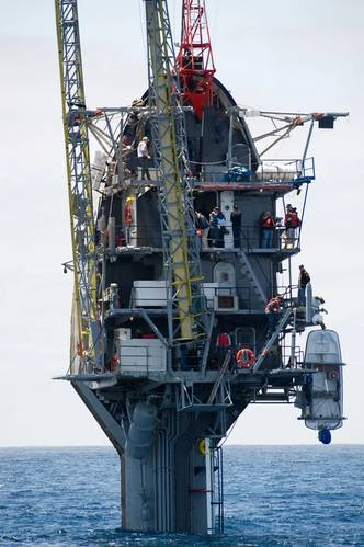 Fifty-five feet remain visible after the crew of the Floating Instrument Platform, or FLIP, partially flood the ballast tanks causing the vessel to turn stern first into the ocean. The 355-foot research vessel, owned by the Office of Naval Research and operated by the Marine Physical Laboratory at Scripps Institution of Oceanography at University of California, conducts investigations in a number of fields, including acoustics, oceanography, meteorology and marine mammal observation. (U.S. Navy
