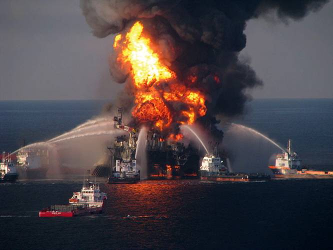 Fire boat crews battle blazing remnants of the Deepwater Horizon rig the day after it exploded on April 20, 2010.  (Photo U.S. Coast Guard)