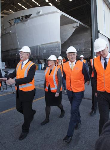 From Left: Senator Chris Back, Senator Linda Reynolds and Prime Minister Malcolm Turnbull in front of Hull 392, a 70m offshore crew transfer vessel under construction for Caspian Marine Services. (Image: Rod Taylor/Austal)