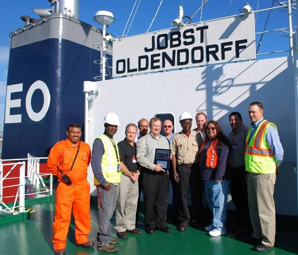 From left: Shihan Mohamed (vessel chief), Chief Officer Shawn Robinson (SGS), Ken McLaughlin (KMBT), Capt. Russell D'Souza (Oldendorff), Mike Schiller (POV), Chris Cummins (PNW Ship & Cargo), Captain Baisie (vessel captain), David Nagel (SGS), Sandra Avila (PNW Ship & Cargo), Noa Lidstone (KMBT), Steve Mickelson (POV)