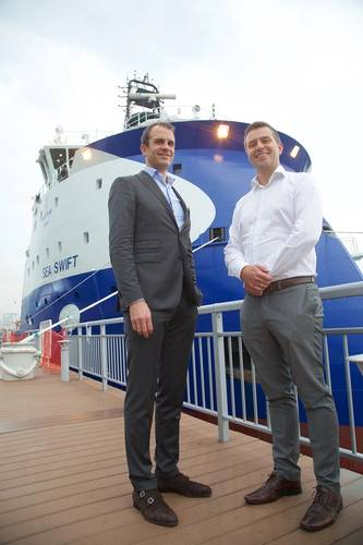 From left: Tallak Strandenæs, Chartering and Marketing Director, and Jon Are Gummedal, Technical Director, in Deep Sea Supply Management AS in front of the Sea Swift (Photo:  ULSTEIN/Gunnar Haug)