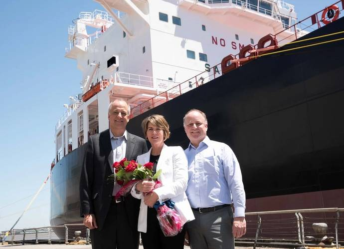 From left to right: Don Templin, Carrie Templin and Tom Crowley, in front of the LNG-ready Jones Act product tanker Louisiana (Photo: Crowley)