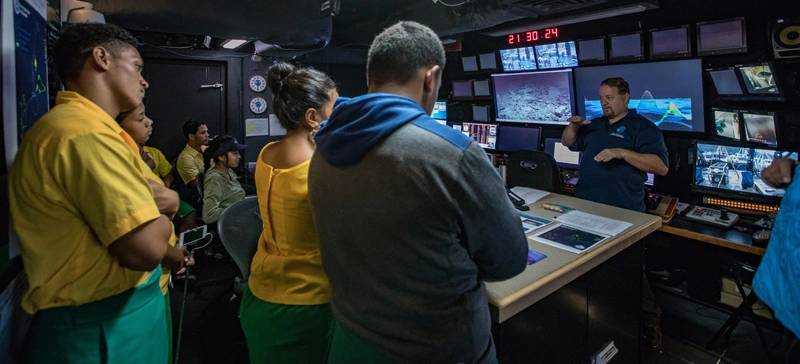 GFOE engineer Roland Brian shows Samoan students the ship's control room. (Photo: Art Howard/GFOE)
