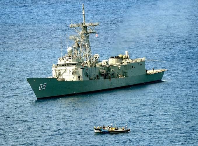 HMAS Melbourne closes on a suspected pirate vessel in the Arabian Sea. (Photo: POA Damien Cox)