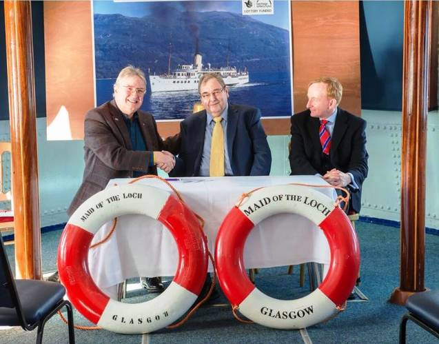 Iain Robertson (LLSC), Neil Patterson (OSD), and Mike Cantlay OBE (VisitScotland), signing the contract on board Maid of the Loch [Paul Saunders Photography]