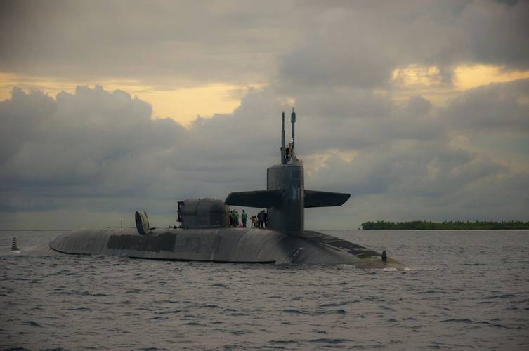 Sailors aboard the guided-missile submarine USS Georgia (SSGN 729) prepare to dock at U.S. Navy Support Facility Diego Garcia in British Indian Ocean Territory, December 2013 (U.S. Navy photo by Alex Smedegard)