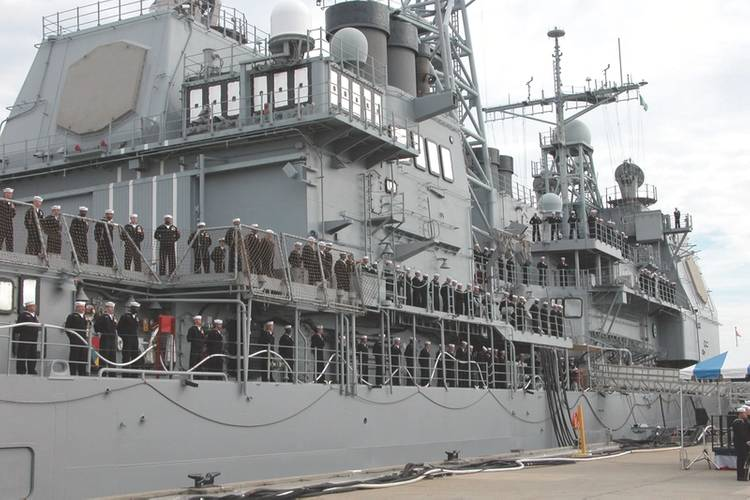 In December 2004, Crew members assigned to the guided missile cruiser USS Yorktown (CG 48) man the rails for the final time in preparation of the order to de-man the ship as she is decommissioned on board Naval Station Pascagoula, Miss. In 1996, the Yorktown was selected to be the testbed for Navy's Smart Ship program, effectively exposing a major flaw in the system when a simple error left the ship blacked out for hours. (U.S. Navy photo by Stacey Byington)