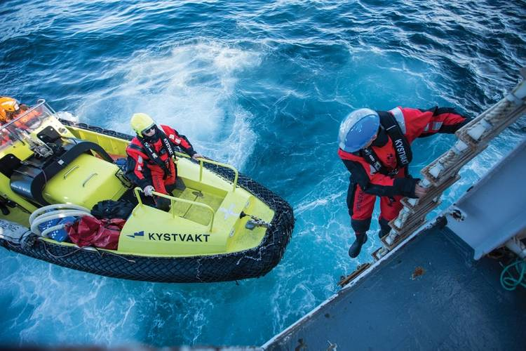 Inspection: (above and below) the Norwegian Coast Guard, or Kystvakten, disembark and check forms following a vessel inspection. Image: The Norwegian Coast Guard