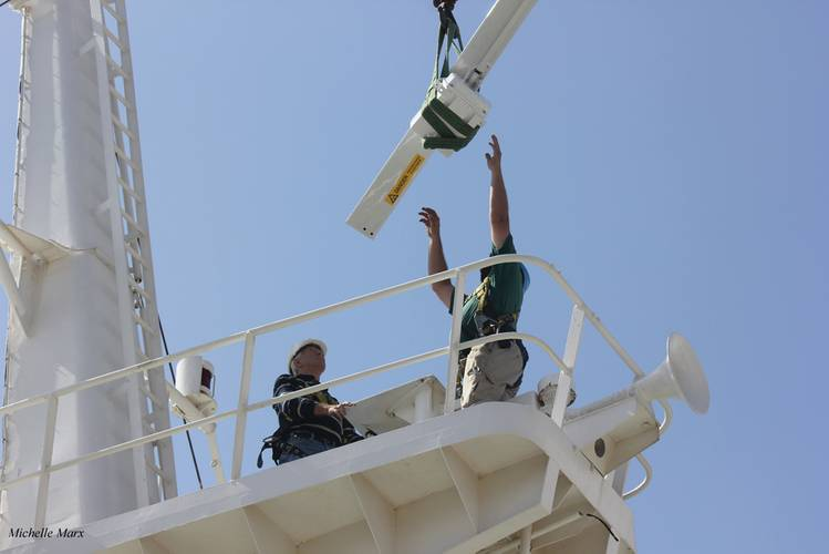 Installing a new Kelvin Hughes Ltd Manta Digital Radar unit  onboard the Africa Mercy. (© Mercy Ships/Michelle Marx)