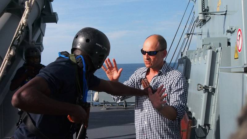 Is there a general propensity for violence in West Africa?  The author finds out in an exchange with a Benin Navy boarding team member during  exercise OBANGAME EXPRESS 2014. Photo: Adrian Kriesch/Alexander Drechsel