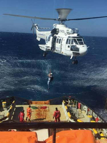 Joey Farrell is lowered via helicopter to a firefighting tug off Grand Canary. Photo courtesy Resolve Marine Group.