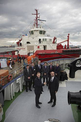 Neil Gilliver, Rolls-Royce, President – Merchant (front left) congratulates Ali Gurun, Sanmar Shipyard, Project Director in front of the world's first LNG power tug, Borgøy.