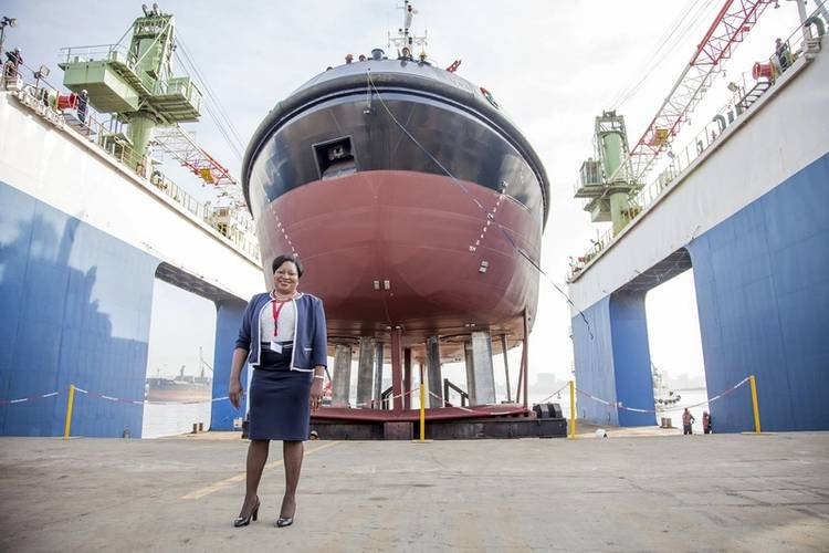 Lady Sponsor of the Usiba tug, Judith Nzimande, with the new tug which will serve at the Port of Richards Bay (Photo: TNPA)