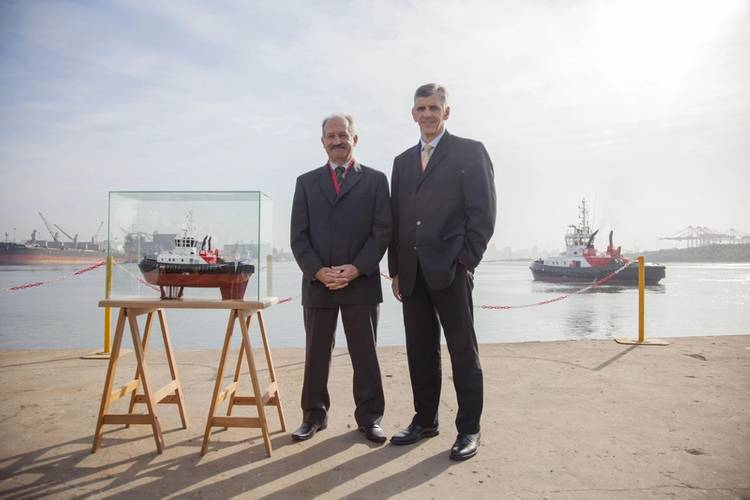 (left) Louis Gontier, Chief Operations Officer of Southern African Shipyards and (right) Nico Walters, General Manager: Strategy of Transnet National Ports Authority during the official handover of the Port of Durban's new Umbilo tug from the ship builder to the Authority. (Photo: TNPA)