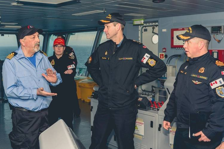 Left to right: Captain Tim Allard, Captain of the Asterix; Commander Sylvain Belair, Commanding Officer of Sea Training; Commodore Skjerpen; Commander of Canadian Fleet Atlantic; and Lieutenant Commander Walsh on the Bridge, on board the NRU Asterix off the Coast Halifax, Nova Scotia on Jan 12, 2018. Photo: John Iglesias / Formation Imaging Services)