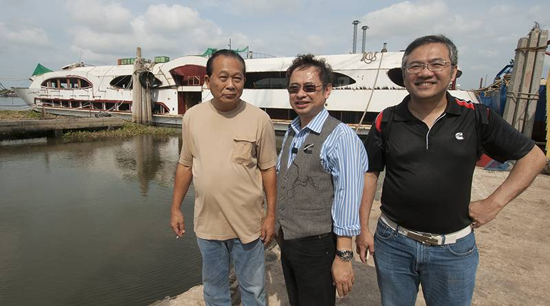 left to right: Sakchai Rujiphapra, Director, Mahachai Dockyard; Sathit Suwanprasert, Senior Engineer, Marketing Dept., Cummins DKSH (Thailand) and Ku Wee Ming, Manager, Regional Marketing, Cummins Asia Pacific with the newly launched Wonderful Pearl currently being fitted out alongside at the shipyard. (Haig-Brown photo courtesy of Cummins Marine)