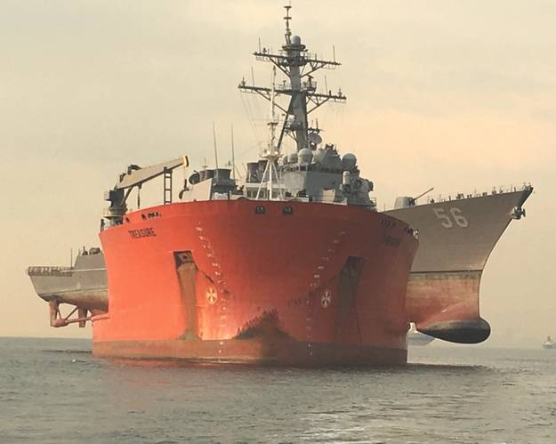The Arleigh Burke-class guided-missile destroyer USS John S. McCain (DDG 56) is loaded onto the heavy lift transport MV Treasure, Oct. 11, 2017. Treasure will transport John S. McCain to Fleet Activities Yokosuka for repairs. (U.S. Navy photo by Keith Lehnhardt)