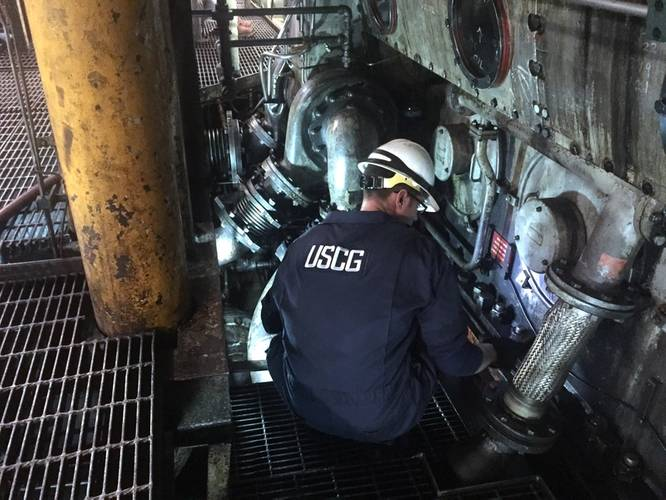 Lt. Gordon Gertiser, a marine inspector with U.S. Coast Guard Sector Sault Ste. Marie, inspects the engine room for possible damage aboard the motor vessel Roger Blough, May 30, 2016. Gertiser and his fellow crewmembers are inspecting the Blough after it ran aground on Gros Cap Reef in Lake Superior (U.S. Coast Guard photo by Creighton Chong)