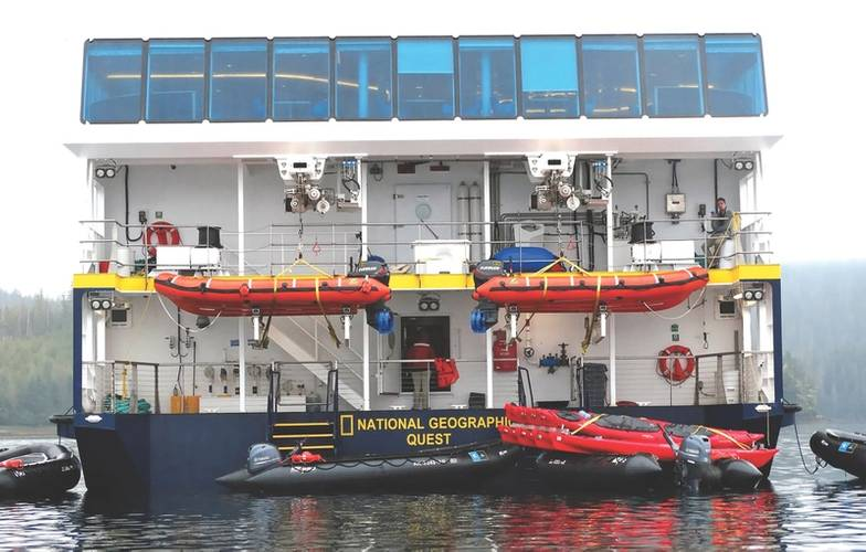 """Marina platforms"": Vestdavits davits with hoisted dinghies on an aft deck designed for easy disembarkation. (Photo: Lindblad Expeditions/Sisse Brimberg & Cotton Coulson)"