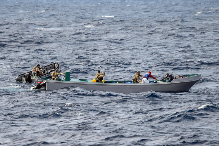 Members of Her Majesty's Canadian Ship NANAIMO and a United States Coast Guard Law Enforcement Detachment collaborate on the boarding of a suspected smuggling vessel in the Eastern Pacific Ocean during Operation CARIBBE on November 21, 2017. Photo: MARPAC Imaging Services
