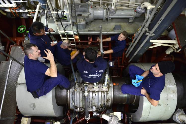 Members of the Coast Guard Cutter Polar Star's engineering department make repairs in the ship's motor room (U.S. Coast Guard photo by Nick Ameen)