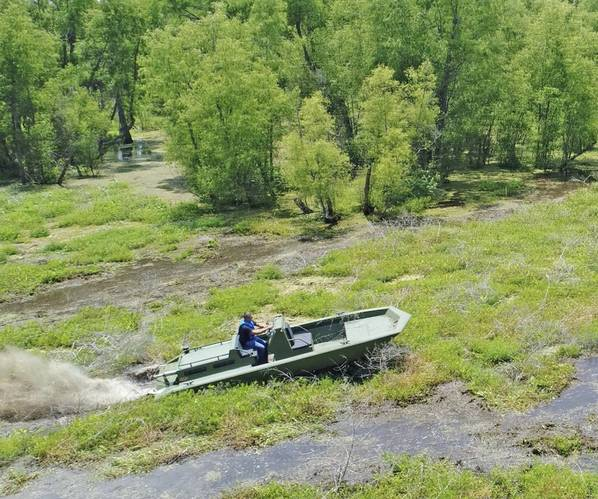 Metal Shark 21 Riverine equipped with Swamp Shark surface drive, shown powering through vegetation in Louisiana's Atchafalaya Basin (Photo: Metal Shark)