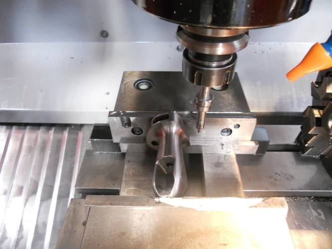 Milling of a rod coupling for Karver System on a four-axis machining center