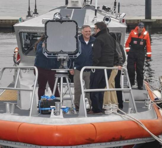 Mr. William Bryan, Department of Homeland Security Under Secretary for Science and Technology, receives a personal demonstration of the Coast Guard Hailing Acoustic and Laser Light Tactical System (HALLTS) installed on a Coast Guard boat, Thursday, Feb. 15, 2018, on the Thames River, New London, Connecticut. Bryan visited the Research and Development Center to observe the HALLTS as part of a larger technology demonstration. (U.S. Coast Guard Photo courtesy of Research and Development Center)