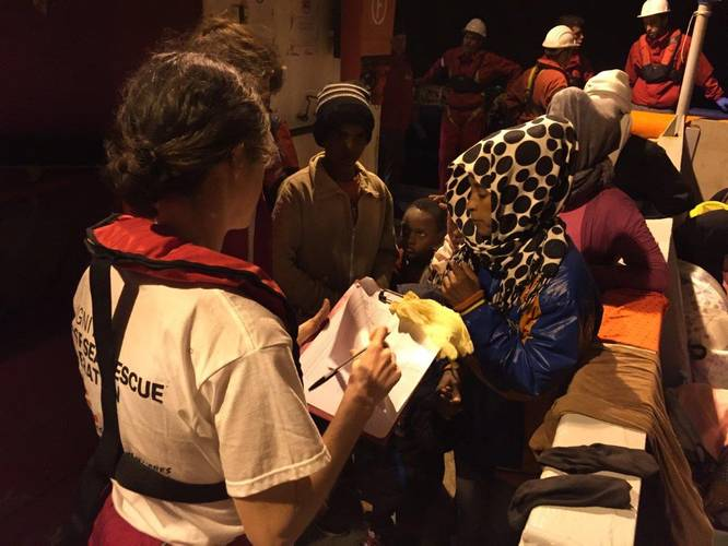 MSF staff attends to one of the people rescued in Dignity I's first operation of 2016. (Photo: MSF)