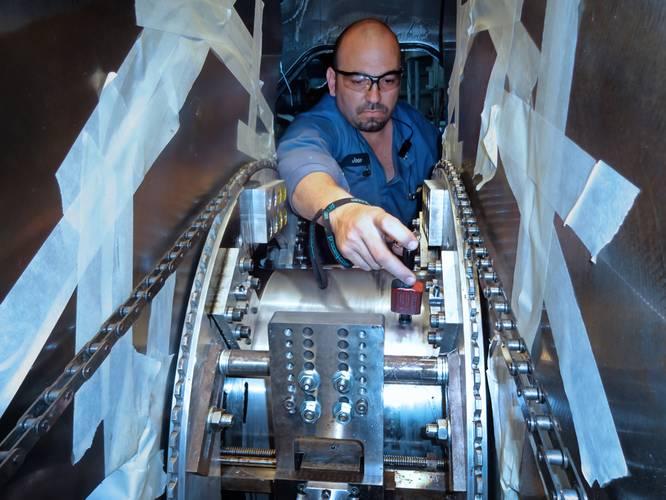 Golten In-Situ specialist checking journal hardness on a Pielstick 10PC2.4V main engine during crankshaft machining prior to annealing.