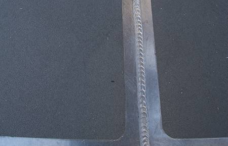 "One of the Mavrik's immaculate welds ""like a stack of dimes"" on the foredeck with well sealed anti-skid pads"