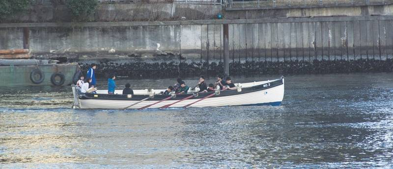 One of TUMSAT's 12-oar cutters being rowed by students near the university campus. (Photo: Alan Haig-Brown)