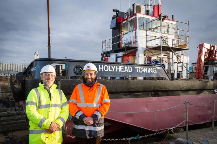 Operations director Kevin Lewis and Captain Mark Meade, chairman of Mustang Marine, alongside the multipurpose workboat Llanddwyn Island, which recently underwent a £250,000 refit at the Pembroke Dock workboat and marine renewable energy device builder (Photo courtesy of Mustang Marine)