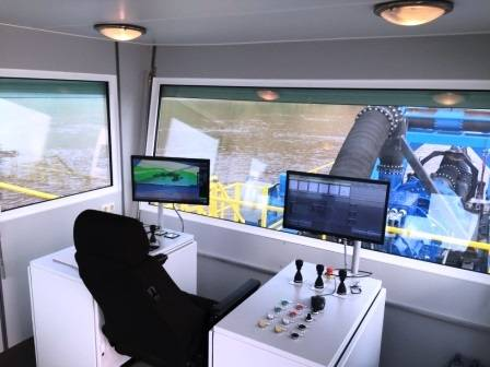 Operator cabin with dredge control and digital GPS sonar systems with map and digital screen read outs (Photo: Idreco)