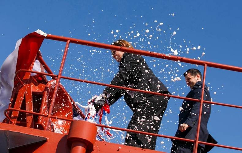 Pamela Beall breaks a of champagne across the hull to christen Ohio (Photo: Crowley)