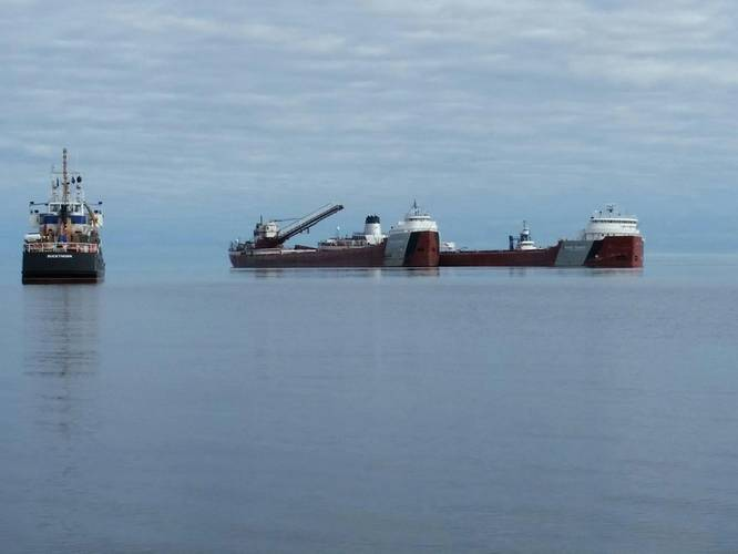 Phillip R. Clarke arrives on scene with the Roger Blough that ran aground on May 27, near Gros Cap Reefs Light in Lake Superior, June 3, 2016. (U.S. Coast Guard photo by Craig Gorman)