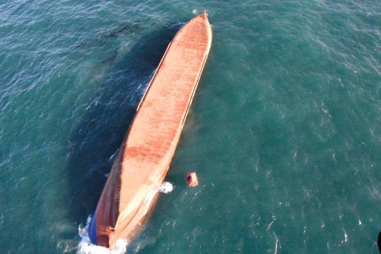 Overturned Cargo Ship in Tow in the English Channel
